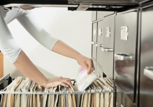 Woman Pulling Files from File Cabinet